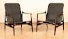 MID CENTURY MODERN LEATHER AND WOOD ARM CHAIRS
