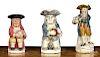 Three Staffordshire toby pitchers, 19th c.