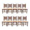 Lote de 10 sillas. Francia. Siglo XX. En talla de madera de roble. Con respaldos semiabiertos y asientos de bejuco.