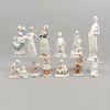 Lote de 12 figuras decorativas. Taiwán. Siglo XX. En porcelana, algunas J. Vazquez. Consta de: enfermera, niña holandesa, otros.