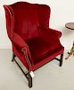 Chippendale style red velvet wing chair