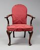 IMPORTANT QUEEN ANNE LOW BACK UPHOLSTERED MAHOGANY OPEN ARMCHAIR