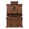 Buffet. Francia. Siglo XX. Estilo Enrique II. En talla de madera de nogal. A 2 cuerpos. Con 3 cajones y 6 puertas. 246 x 160 x 56 cm.
