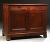 French Provincial Carved Cherry Louis Philippe Sideboard, 19th c., the canted corner top over two frieze drawers and double cupboard...