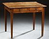 French Provincial Louis Philippe Carved Elm Occasional Table, 19th c., the inlaid highly figured top over two frieze drawers, on tap...