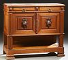 French Henri II Style Carved Oak Marble Top Server, late 19th c., the inset highly figured tan marble over two frieze drawers and do...