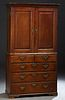 English Carved Oak Linen Press, 19th c., the stepped ogee crown over double cupboard doors over a shelved interior, on a base with t...