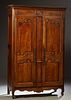 French Provincial Carved Walnut Louis XV Style Armoire, early 19th c., the stepped rounded corner crown over double doors with doubl...