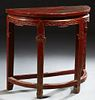 Chinese Polychromed Oak Demilune Table, late 19th c., the top over a wide skirt with floral and tendril carving, on tapered square l...