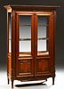 French Louis XVI Style Carved Cherry Vitrine, 20th c., the dentillated stepped crown over double beveled glazed doors with fielded l...