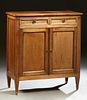 French Louis XVI Style Carved Cherry Sideboard, 20th c., the stepped rectangular top over two frieze drawers and double cupboard doo...