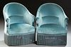 Pair of French Upholstered Barrel Back Armchairs, c. 1870, with an arched upholstered back and arms, above a bowed seat, on turned t...