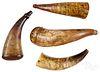 Four scrimshaw powder horns