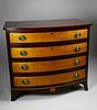 American Tiger Maple and Mahogany Bow Front Chest of Drawers, circa 1810