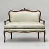 French Provincial-style Carved and Upholstered Fruitwood Settee