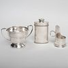 Asprey Silver Chamberstick, a French Silver Talcum Container and George V Silver Cup