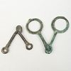 Two Patinated Bronze Horse Bits
