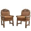 Pair of armchairs. 20th century. Carved in wood. Closed backrests with cushions and seats in camel upholstery.