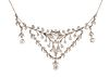 A BELLE EPOQUE DIAMOND NECKLACE, the swags, drapes and drops all set with o