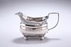 A GEORGE III SILVER CREAM JUG,?London 1810, with reeded edge and handle, ra