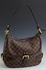 Louis Vuitton Damier Ebene Highbury, in brown and tobacco Louis Vuitton monogram coated canvas, the brass zipper closure opening to...