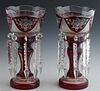 Pair of Cut-to-Clear Ruby Glass Lusters, c. 1900, the scalloped rims with floral and hatchwork panels, suspending long button and spear prisms, on a c