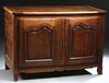 French Louis XV Style Carved Walnut Sideboard, 19th c., the top hinged and lifting to open storage over double arched fielded panel cupboard doors, wi