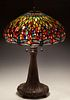 "Tiffany Style Dragonfly Table Lamp, late 20th c., by Dale Tiffany, the slag glass shade mounted with numerous cabochon ""jewels,"" on a naturalistic bro"