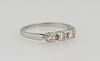 Lady's Platinum Dinner Ring, the top with a row of three 10 point round diamond, total diamond wt.-.3 cts, Size 5 3/4.