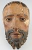 Italian Polychromed Carved Wood Santo Head, 19th c., in original paint, H.- 10 in., W.-5 in., D.- 4 in. Provenance: Personal collection of Paul Rosent