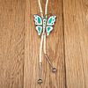 Lambert Homer, Jr. (Zuni, 20th century) Silver, Shell, and Turquoise Butterfly Bolo Tie, ex. C.G. Wallace Collection