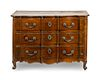 A Louis XV Provincial Style Serpentine-Fronted Walnut Commode Height 36 x width 50 3/4 x depth 24 1/4 inches.