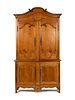 A Louis XV Provincial Style Carved Fruitwood Buffet a Deux Corps Height 95 x width 66 x depth 29 inches.