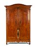 A Continental Parquety Inlaid and Carved Fruitwood Armoire Height 110 x width 55 1/2 x depth 16 inches.