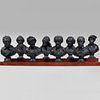 Group of Eight Ebonized Plaster Busts of Learned Gentlemen