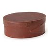 A GOOD 19TH CENTURY OVAL PANTRY BOX IN OLD RED PAINT