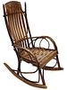 A FOLKY ADIRONDACK TYPE BENTWOOD AND TWIG ROCKING CHAIR