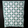 AN EARLY 20TH CENTURY INDIAN WEDDING RING PATTERN QUILT
