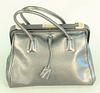 "Black Prada handbag, Madras Cerniera Nero, black leather purse with original tags and dust bag, ht. 9"", wd. 13""."