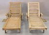 """Two teak lounges, each with pull out tables, lg. 78""""."""