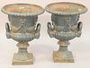 """Pair iron outdoor urns, ht. 23"""", dia. 16 1/2""""."""