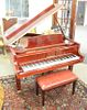 D.H. Baldwin baby grand piano and bench, C152, in excellent condition.