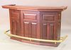 """Cherry bar with pull out blackjack table having brass foot rail, ht. 43"""", wd. 72"""", dp. 27""""."""