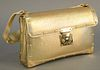 """Louis Vuitton purse handbag gold, Pochette Sellier in gold and satin monogrammed interior with dust bag, ht. 5 1/2"""", wd. 9""""."""