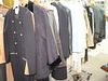 Rack of clothing to include dresses, coats, leather jacket, etc.