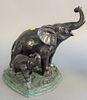 "Maitland-Smith bronze figure of two elephants, ht. 12"", wd. 12""."