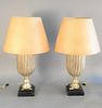 """Pair of silvered wood lamps each in urn form on a black lacquered square base, ht. 19 1/2"""". Estate of Marilyn Ware, Strasburg, PA."""