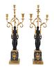 A Pair of Empire Gilt and Patinated Bronze and Marble Three-Light Figural Candelabra