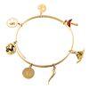 A Bangle Charm Bracelet in 18K & Seven Gold Charms