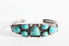 A Navajo Seven Stone Turquoise and Silver Bracelet, ca. 1950